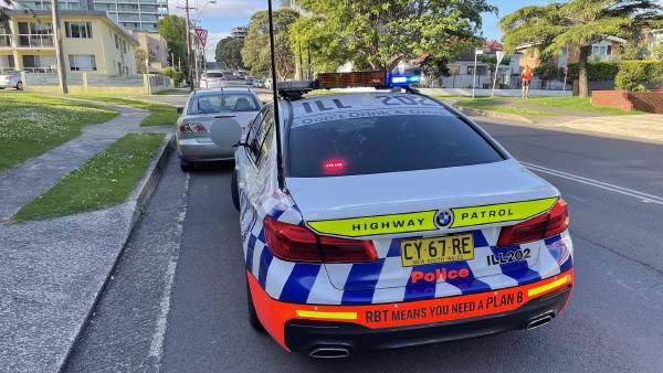 Banned motorist allegedly caught driving after reporting on bail